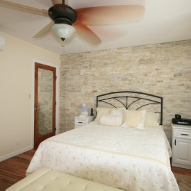 New Bedroom With Stone Accented Wall & Mini Split