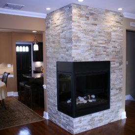Stone Veneer Accent Walls With An Enclosed Fireplace